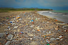 Beach Dump. Tropical beach with garbage as far as the eys can see Stock Photography