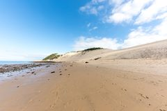 The beach of the dune of Pilat, Arcachon Bay, France. The beach of the dune of Pilat, or Pyla, in France, on the Arcachon Bay : the highest sand dune in Europe Stock Photo