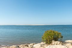 The beach of the dune of Pilat on the Arcachon Bay, France. View on the sandbank of Arguin from the beach of the dune of Pilat, or Pyla, in France, on the Stock Photography