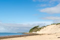 The beach of the dune of Pilat, Arcachon Bay, France. The beach of the dune of Pilat, or Pyla, in France, on the Arcachon Bay : the highest sand dune in Europe Royalty Free Stock Photos