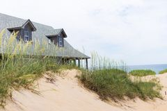 Beach dunes and home. Behind Stock Photography