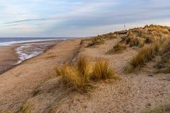 Winterton-on-Sea, Norfolk, England, UK. The beach and dunes in Winterton-on-Sea, Norfolk, England, UK royalty free stock photo