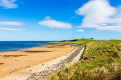 Beach at Dunstanburgh Castle in Northumberland Stock Image