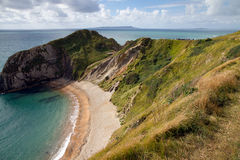 Beach at Durdle Door Dorset. Beach and cliffs at Durdle Door Dorset Stock Images