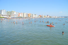 The beach of Durres. DURRES, ALBANIA – August 29, 2015: More than 20 km beach strip in the bay of Durres is rapidly developed during the last few years Stock Photos