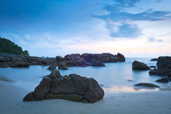 Beach at Dusk. Time-lapse of beach at dusk with rocks Stock Photo