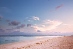 Beach on dusk with pink sand Stock Images