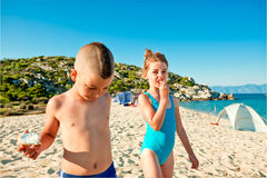 Beach eating kids energy Royalty Free Stock Images