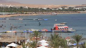 Beach in Egypt. People bath and sunbathe on the beach in Sharm El Sheikh, Egypt stock video