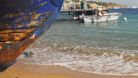 Beach in Egypt. Resort Red Sea Coast. Coast guard boat near the seaport. Beach in Egypt. Coast guard boat near the seaport. Resort Red Sea Coast. Daytime stock footage