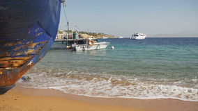 Beach in Egypt. Resort Red Sea Coast. Coast guard boat near the seaport. EGYPT, SOUTH SINAI, SHARM EL SHEIKH, NOVEMBER 28, 2016: Beach in Egypt. Coast guard stock video footage