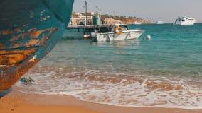 Beach in Egypt. Resort Red Sea Coast. Coast guard boat near the seaport. EGYPT, SOUTH SINAI, SHARM EL SHEIKH, NOVEMBER 28, 2016: Beach in Egypt. Coast guard stock footage