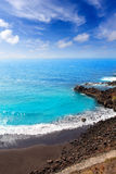 Beach el Bollullo black brown sand and aqua water Stock Photography