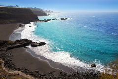 Beach el Bollullo black brown sand and aqua water Royalty Free Stock Photography