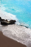 Beach el Bollullo black brown sand and aqua water Royalty Free Stock Image