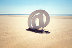 At the beach email concept stock photos