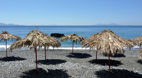 Beach at Embros Therme. With parasols royalty free stock photo