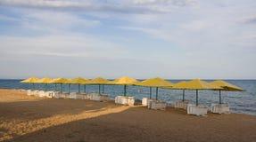 The beach. Empty beach chairs on the beach Royalty Free Stock Photos