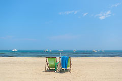 Beach with empty chairs Royalty Free Stock Photo