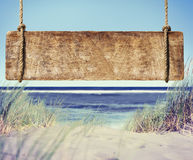 Beach with Empty Plank Sign Royalty Free Stock Photos