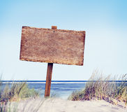 Beach with Empty Plank Sign Stock Photos