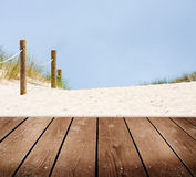 Beach and empty wooden deck table. Royalty Free Stock Images