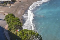 Beach, end of swimming season in Sorrento. Concrete blocks used as sea defense in Italy royalty free stock image