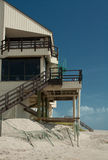 Beach Erosion. A house on the beach has lost part of its supporting structure from the beach erosion occuring during hurricanes and tropical storms in Florida stock photography