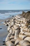 Beach erosion. Sand bags along the beach in North Carolina to protect from heavy surf and erosion stock image