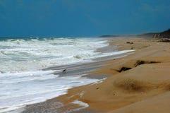 Beach erosion on the Atlantic. Hard waves crashing on the beach from the Atlantic ocean causing sand erosion stock image