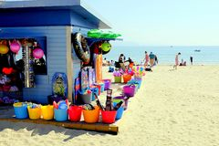 Beach Essentials, Weymouth, Dorset, UK. Weymouth, Dorset, UK. May 19, 2018.  Holidaymakers relaxing and a beach kiosk selling beach essentials on the beach at Stock Image