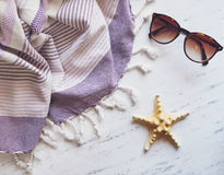 Beach essentials on white marble. Royalty Free Stock Image
