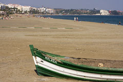 Beach At Estepona. An old boat, filled with sand, is used as a barbecue pit on the beach at Estepona on Spain's Costa del Sol royalty free stock image