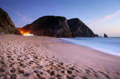 Beach at evening. Restaurant lights in a sandy beach in the evening Royalty Free Stock Photography