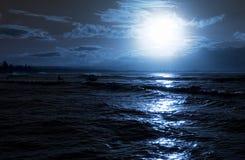 Beach evening. Moon rise over calm ocean stock photography