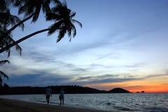 beach in evening stock photos