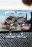 Beach evening on the sunset with two glasses Stock Image
