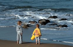Beach Family. Two children visiting the beach Royalty Free Stock Photos