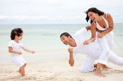 Beach family pulling a rope Stock Photography