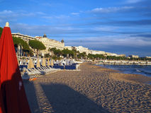 Beach and famous hotels along Promenade de la Croisette Cannes F. Cannes France the French Riviera beach and famous hotels along The Promenade de la Croisette Stock Images