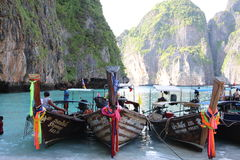 The beach, with famous long tail boats, Thailand. Royalty Free Stock Images