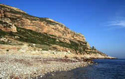 The beach of Faraglione in Levanzo. Small pebble beach with crystal clear sea - Egadi islands Royalty Free Stock Photos
