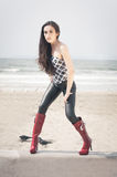 Beach Fashion Model. Beautiful fashion model modeling clothing designs at the beach Stock Photos