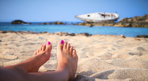 Beach feet. A girl sunbathes on a beach of Formentera in the Balearic Islands, Spain Stock Images