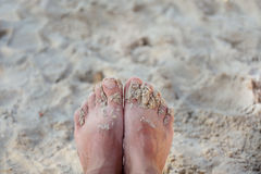 Beach with feet of the man on sand Stock Photo