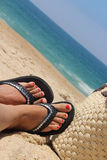 Beach and female feet. Relaxation on the beach and female feet Royalty Free Stock Photos