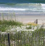 Beach fence. Sand dune and beach in North Carolina Stock Photos