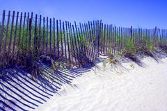 Beach Fence. The beach dunes are protected by fences posted along their boundaries royalty free stock photos