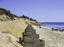 Beach fence on a beach in Eastham, MA Cape Cod. Stock Images