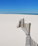 Beach Fence and Sand Royalty Free Stock Photos